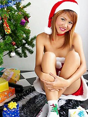 Santa's favorite little helper Jas shows her gifts