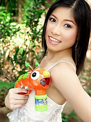 Asian cutie Bovi Ontida is posing naked with a bubble gun that would be better if it could shoot out an endless stream of sperm.