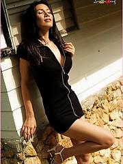 Un dressed in black, Loretta enjoys her naked freedom