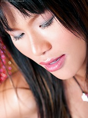 Ling Ling does a striptease behind a wall of beads