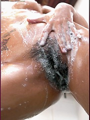 Annita Sang scrubs tight wet pussy in the shower