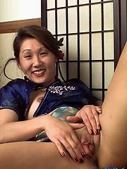 Mama san Kiyani strips outof her kimono