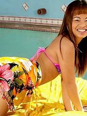 Kita strips out of her sexy bikini while outdoors near the pool