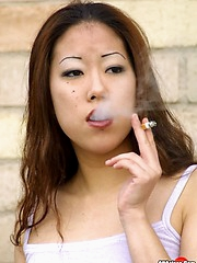 Ayoko steps out for a smoke & shows off her smoking twat