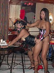 Thai girls enjoy some strap-on love