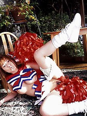 Naughty cheerleader shows her fine assets