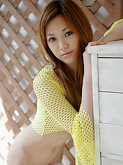 Irrisistable asian girl topless outdoors