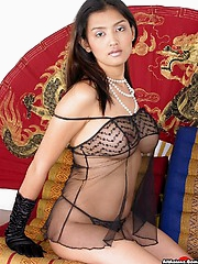 Big tittied Thai spreads her spicy pink pussy