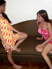 Asian lesbians play with their shaved cunts