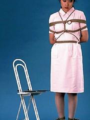 Horny Japanese nurse tied up on the floor