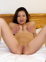 Horny Asian slut spreads her pink pussy lips