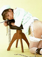 Nurse in lingerie gets tied up and collared