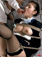 Tied up busty babe has her nipples teased