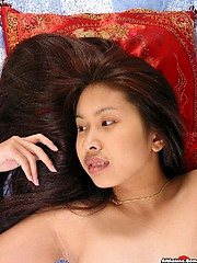 Thai cutie shows off her hairy snatch