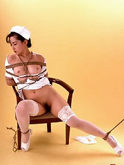 Asian nurse gets all tied up at work