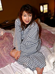 Akane reveals her tight hairy pussy