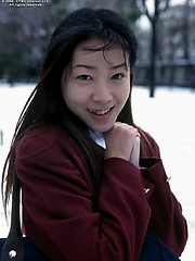 Japanese cutie Aika plays hard to get in the snow