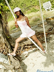 Skinny Thai babe Tussinee playing on a rope swing flashes her white panties