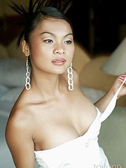 Amazing Thai girl Tailynn looking hot in a sexy white dress