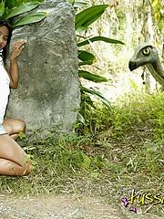 Hot Asian teen posing by old dinosaur ruins teasing us