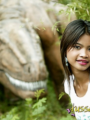 Hot Asian teen posing by old dinosaur ruins teasing us