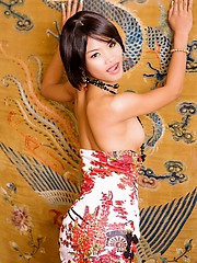 Beautiful Tussinee dressed like a China doll strips out of her clothes